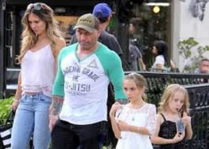 Husband and wife Joe Rogan and Jessica Rogan with their children