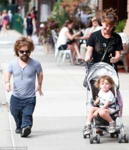 Peter and Erica on awalk with their cute daughter.