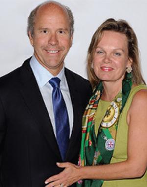 April McClain Delaney with her husband John Delaney smilig