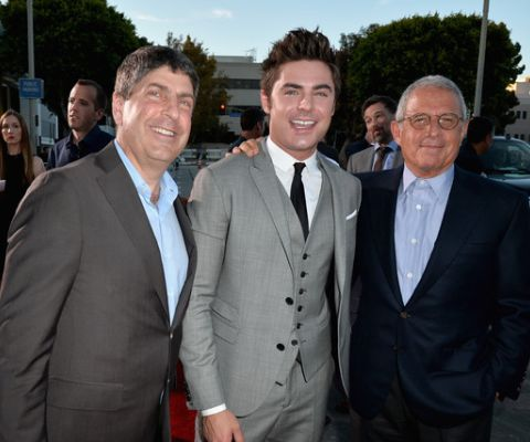 Zac Efron, Jeff Shell along with Ron Meyer at the Neighbors Premieres and smiling at the camera