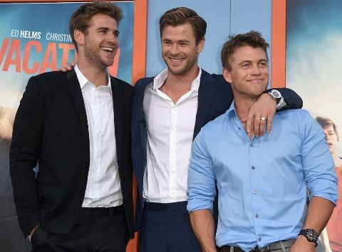 Liam Hemsworth with his brothers