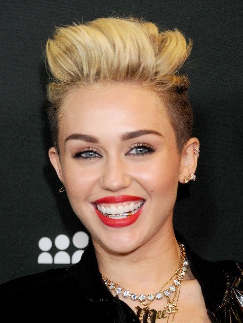 Miley Cyrus smiling for a photo