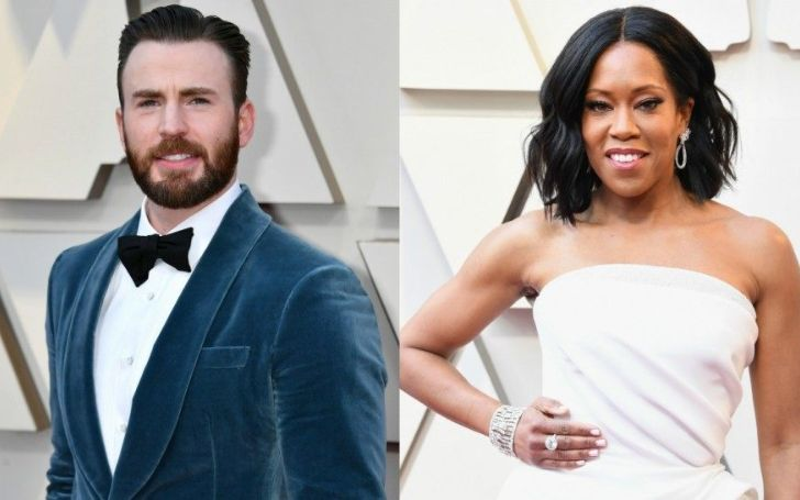 Regina King Escorted To the Stage by Chris Evans while she Tumbled While Receiving The Oscar for Best SupportingActress
