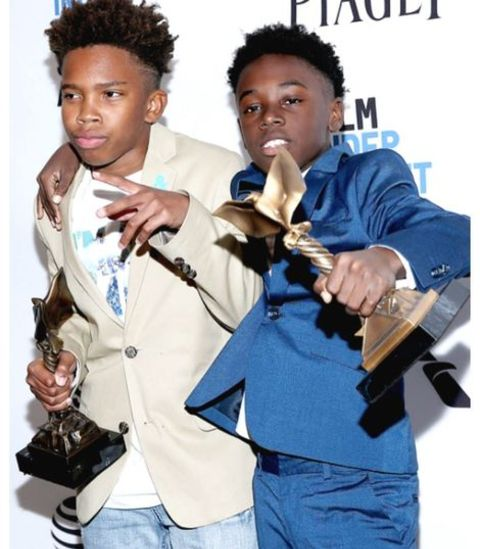 Alex R. Hibbert and Jaden Skii posing for a photo with their Awards
