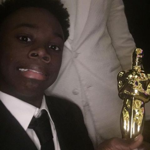 Alex R. Hibbert hold his Award