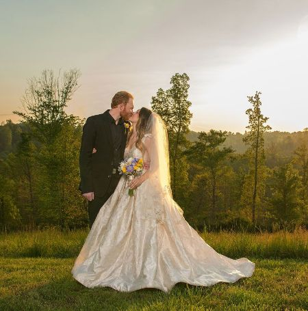 Eric Paslay and Natalie Harker on ther Wedding day looking happy