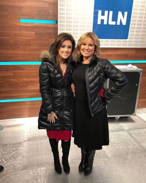 Jennifer Westhoven posing for a photo with her co-host