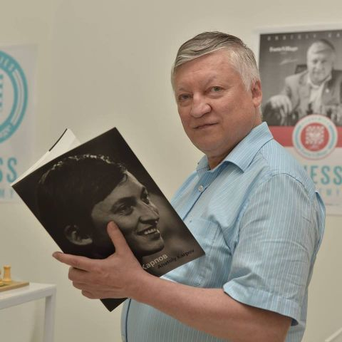Anatoly Karpov holding his book.