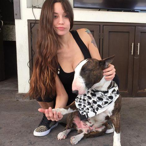 Melanie Pavola with her pet dog