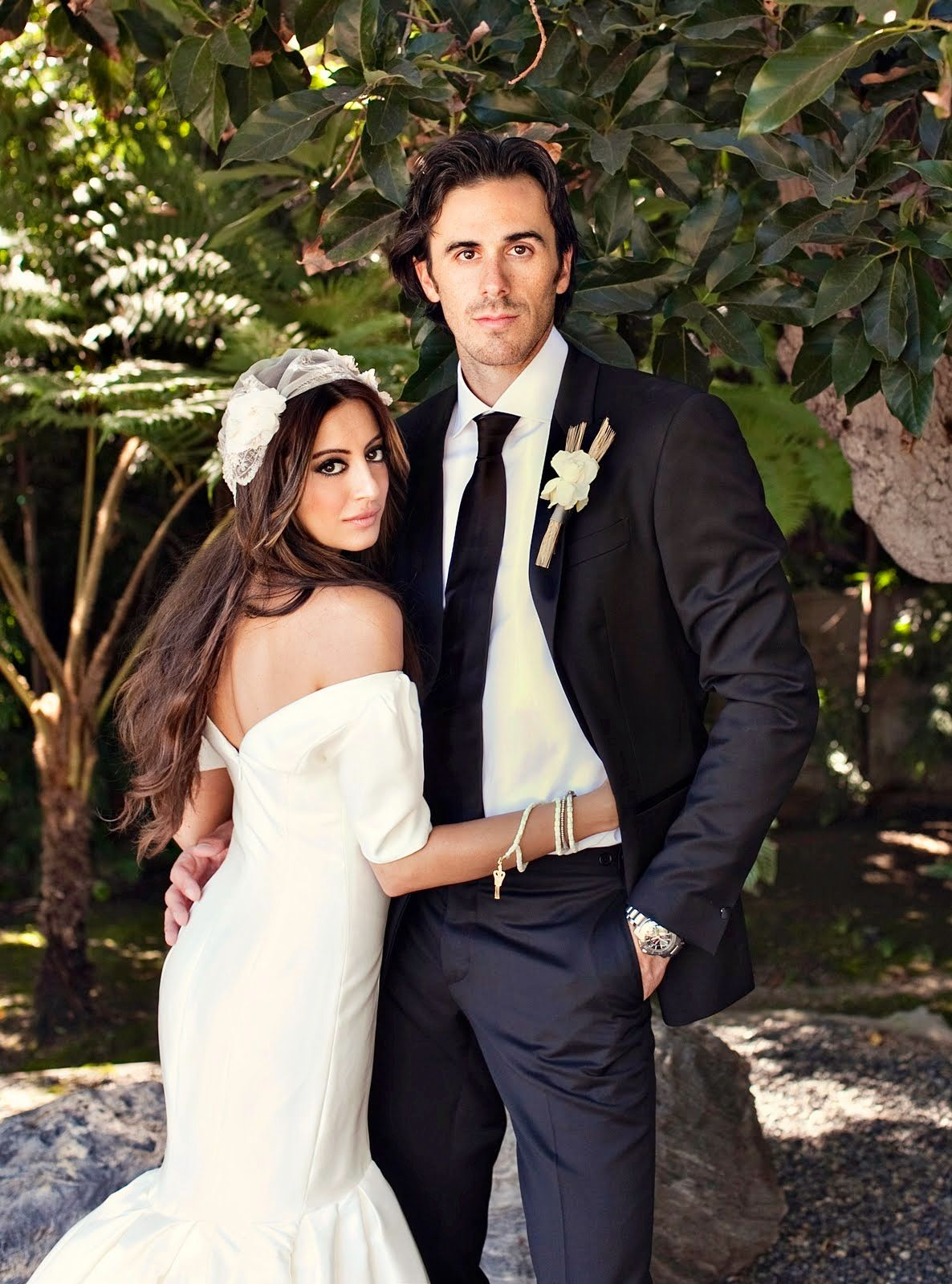 Noureen DeWulf with her spouse Ryan Miller at their wedding day.