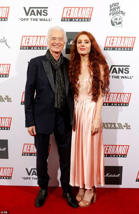 Scarlett Sabet wearing a pink silk gown and Jimmy Page in a tuxedo at the red carpets.