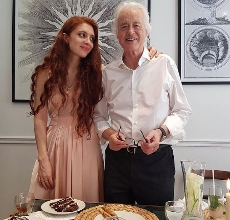Scarlett Sabet is in a relationship with Jimmy Page.