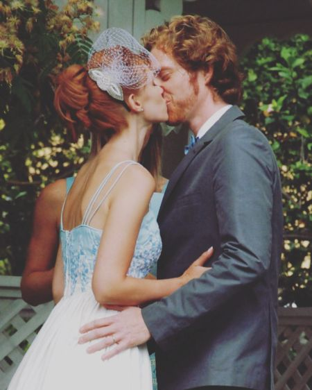 Julie McNiven and Michael Blackman Beck kissing on their wedding day.