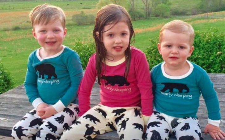 Scarlett Wiles Sanders in red while her younger brothers in green.