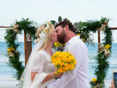 Lawrence Faulborm wlaked down the aisle with his wife Kerri Giddish