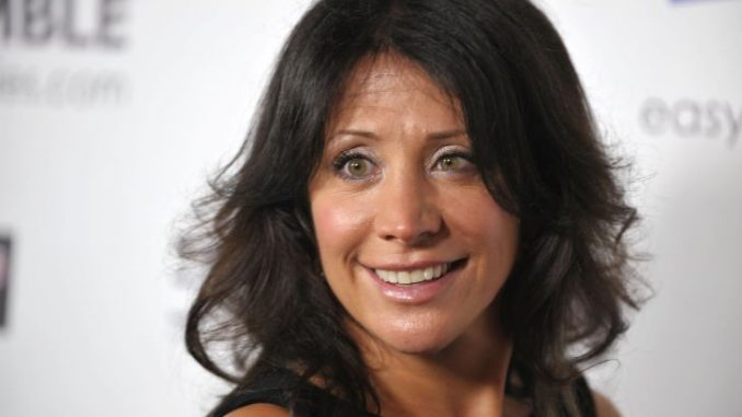 Cheri Oteri smiling at the camera as she looks beautiful with her brown hair and green eyes.