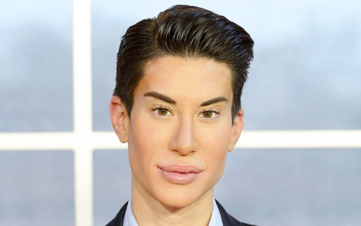 Justin Jedlica wearing a suit looks at the camera.