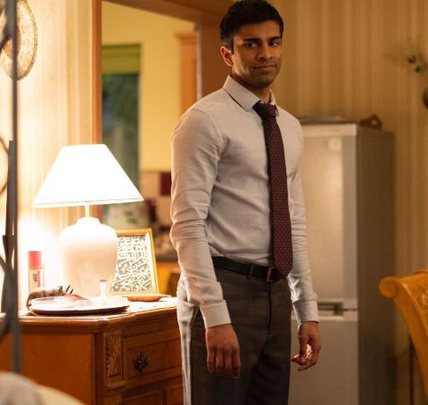 Nikesh Patel in a white shirt, dark tie and a black pant.