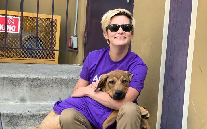 Jacqueline Toboni in a purple t-shirt with dog.