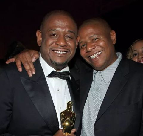 Kenn Whitaker with brother Forest Whitaker and his award.