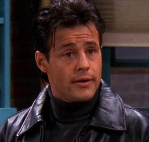 Louis Mandylor speaking and wearing black leather jacket.