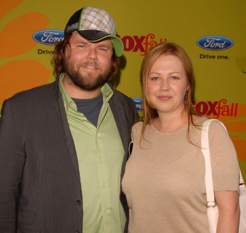 Carrie Ruscheinsky in skin colored top alongside his renowned husband, Tyler Labine.