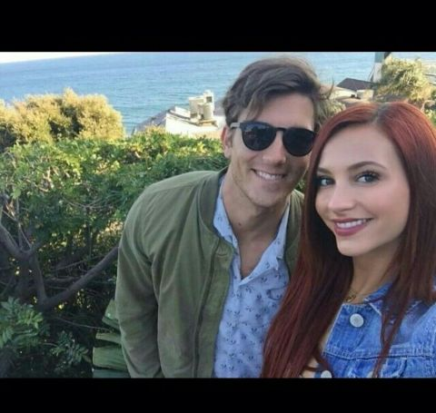 Brent Antonello in green jacket, blue shirt with red-haired girlfriend Taylor Ackerman