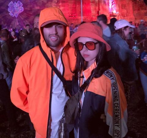 Bel Powley in a orange-black jacket with boyfriend Douglas Booth.