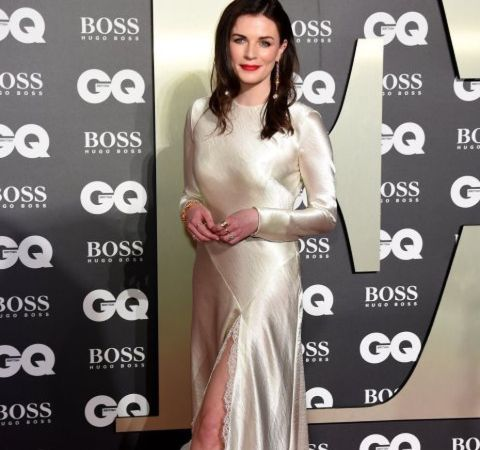 Netflix star Aisling Bea in a white dress.