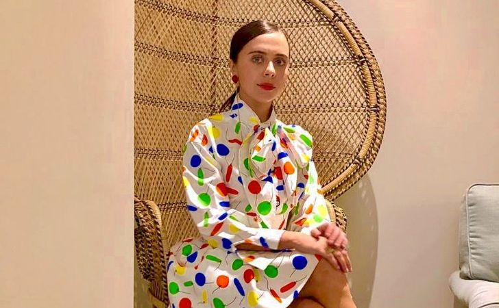 Bel Powley poses during a photoshoot in a colorful dress.