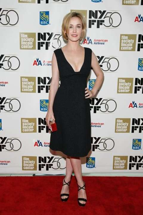 Actress, Dominique McElligott giving a pose in her black dress in an event.