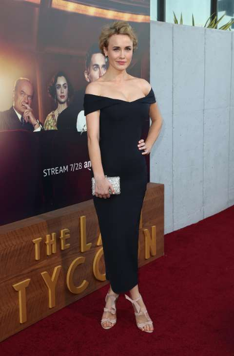 Actress, Dominique McElligott giving a pose in her wonderful black one piece dress.