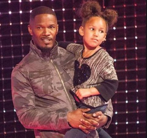 Jamie Foxx carrying her daughter Annalise Bishop in his arms.