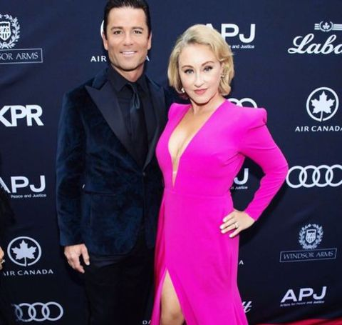 Yannick Bisson and his wife attending an event.