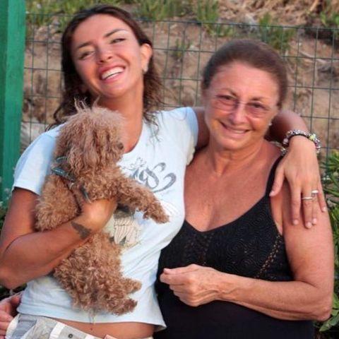Francesca Rettondini standing along side her mother.