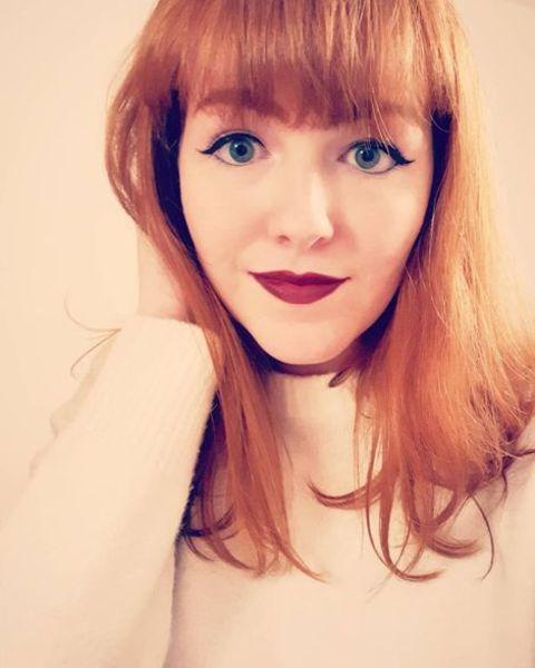 Singer, Josie Charlwood's selfie where she is shocashing her red hair and beautiful green eyes.
