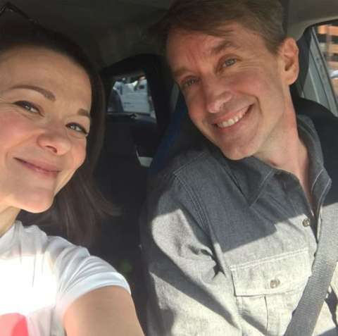 Actress, Maribeth Monroe taking a selfie with her husband Andy in the car.
