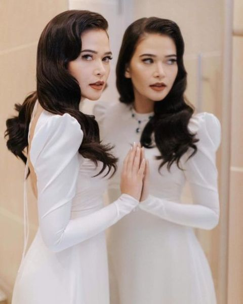 Bela Padilla giving a pose while wearing a white dress.