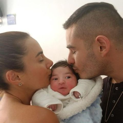 Johanna Fadul holding her newly born son Gaby along with her husband.