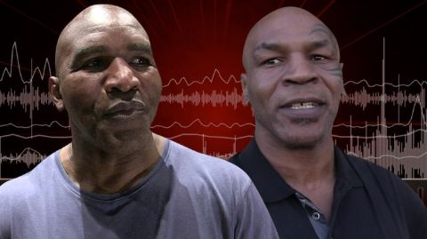 Evander Holyfield with Mike Tyson.