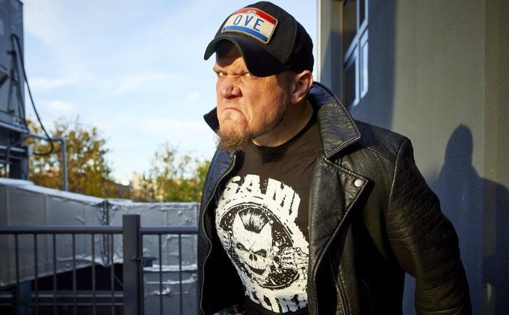 Sami Callihan in a black t-shirt and black cap.
