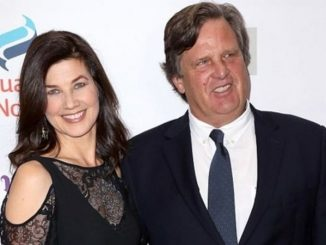 David Mleczko in a black suit with wife Daphne Zuniga.
