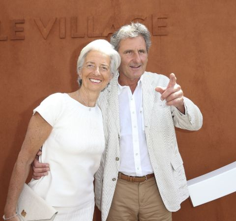 Xavier Giocanti in a white suit with wife Christine Lagarde.