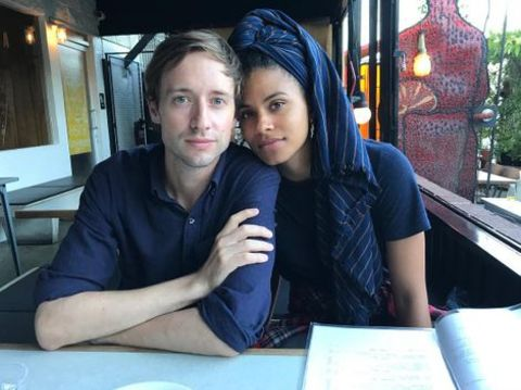David Rysdahl giving a pose with his girlfriend, Zazie Beetz in a resturant.