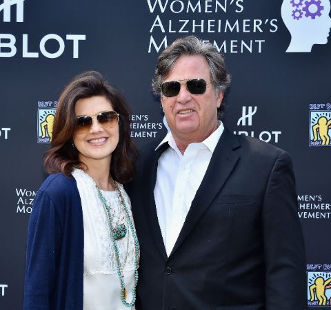 David Mleczko in black suit with wife Daphne Zuniga.
