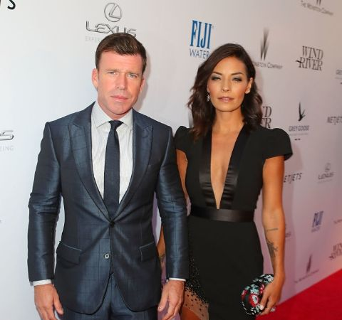 Actress, Nicole Muirbrook giving a pose with her spouse, Taylor Sheridan.