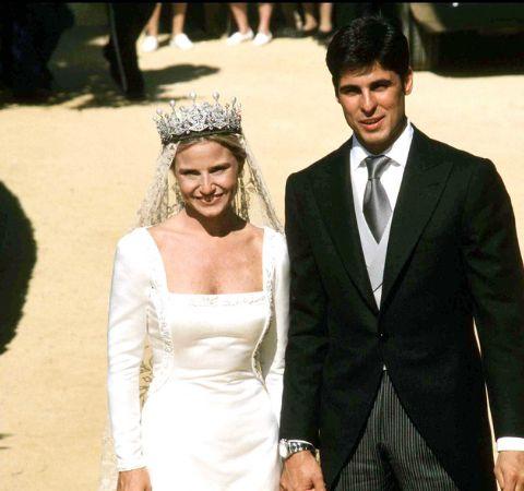 Eugenia Martinez de Irujo in a white wedding gown with ex-husband Fran Rivera.