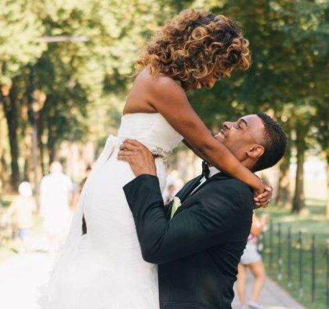 Jeannette Reyes in her wedding dress with boyfriend Robert Burton.