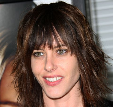 Katherine Moennig poses for a photoshoot in an event.