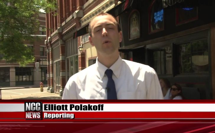 ESPN reporter Elliott Polakoff in a white shirt while reporting a news.